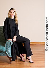 Businesslady 80 - Blond haired busines woman, sitting on a...