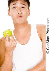 Hmmmmm - A asian man makes a strange face whilst holding an...