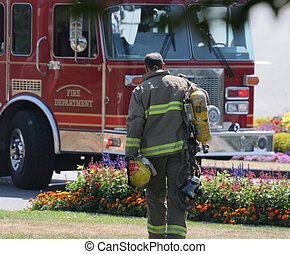 Fireman - Tired fireman walking back to the fire truck