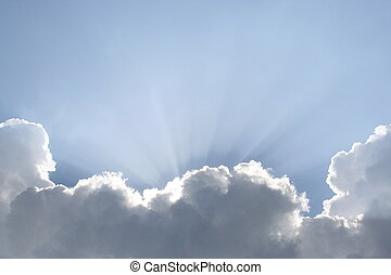 Heavenly Light - The sun shining out from behind the clouds.