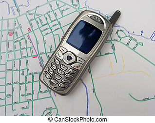 cell phone map - cell phone on blurred map of a small town