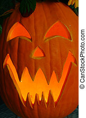 Jack O Lantern - Halloween lighted pumpkin carved with a...