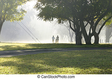 Two Joggers - Two runners in the park on a misty morning