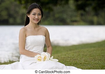 Asian Bride 9 - A beautiful young asian woman sits by the...