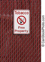 no smoking - tobacco free property sign on school fence