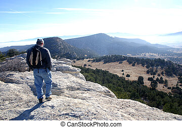 Hiker on Ridge - Hiker on top of ridge overlooking Red...