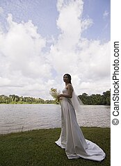 Asian Bride 16 - A beautiful asian woman stands by the side...