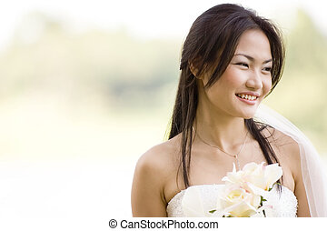 Outdoor Bride 3 - A beautiful asian bride poses outside
