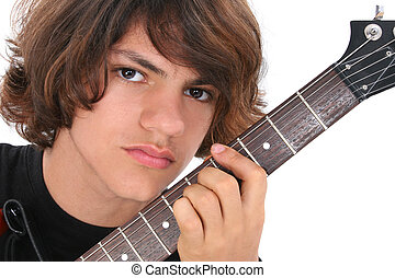 Teen Boy Guitar - Close Up of Native American Teen Boy With...
