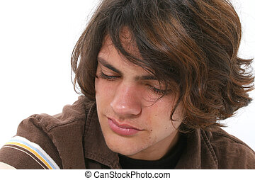 Teen Boy Crying - Close up of teen boy crying. Tears in eyes...