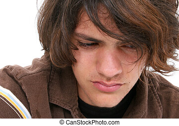 Close Up of Teen Boy - Close up of teen boy crying. Tears in...