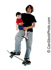 Teen Toddler Boy - Teen boy holding toddler boy while...