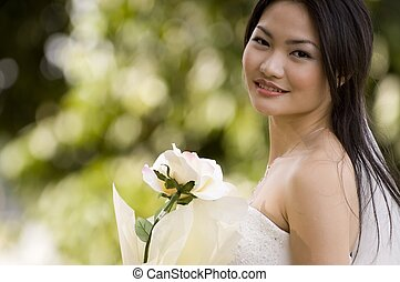 Outdoor Bride 4 - A beautiful asian woman poses in her...