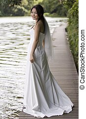 Outdoor Bride 5 - A beautiful asian woman in a wedding dress...