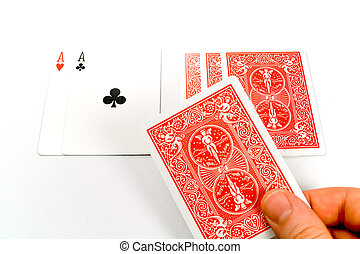 Dealing stud poker - A hand dealing a card in a round of...