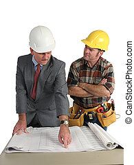 Going Over Blueprints - an engineer explaining the...