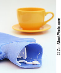Get well soon! - A yellow cup and a blue hot water bottle.