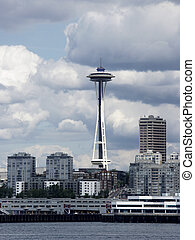 Needle's Setting - Seattle Space Needle amid cityscape...