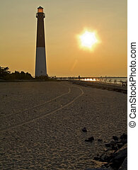 Lighthouse and Sand - This is a sunset shot of the Barnegat...