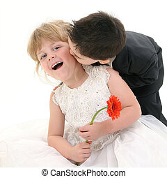 Boy Girl Kiss Laugh - Toddler boy giving young girl a kiss...
