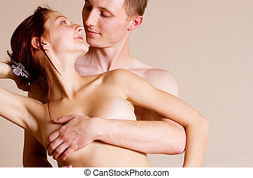 couple 11 - Topless girl standing in front of her boyfriend...