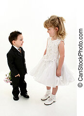 Boy Girl Flowers - Toddler boy in suit giving flowers to...