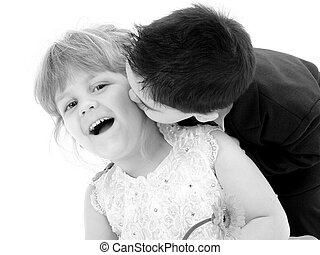 Boy Girl Child Kiss - Toddler boy giving young girl a kiss...