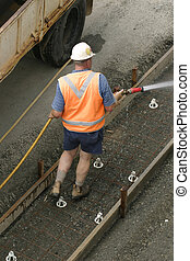 Tradesmen Hosing - A worker using a hose Some motion in one...