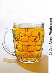 Beer - A pint of lager in an English beer mug.