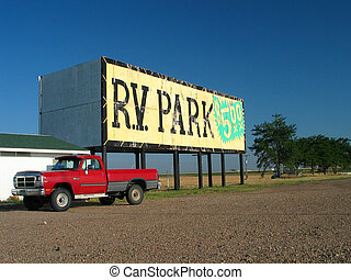 red pickup - rv park billboard set against a blue sky