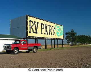 red pickup - rv park billboard set against a blue sky