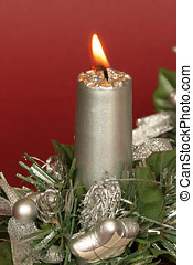 Christmas candle - Silvery christmas candle on dark red...