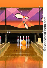 Bowling - A bowling alley Gutter guards are up and ball is...