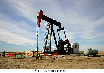 Oil Pump Jack - An oil pump jack in Southern Alberta