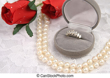 Love & Lace - a diamond ring, string of pearls and roses on...