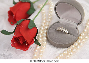 Romantic Engagement 1 - an engagement ring, pearls red roses...