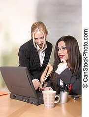 Business Solutions - Two business colleagues work and...