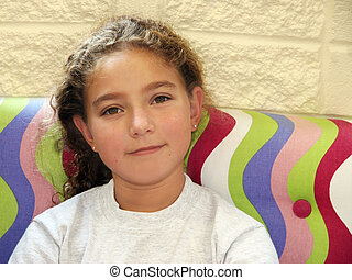 Cute girl sitting on a couch