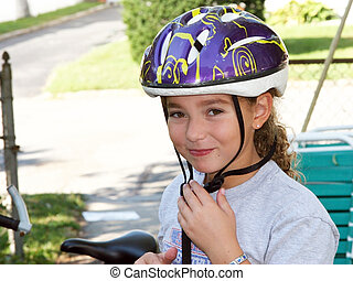 Cute girl in a helmet is going for a ride