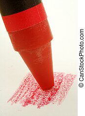 Red Crayon - A red crayon coloring on paper