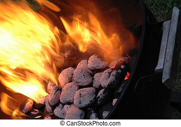 flaming charcoals in kettle