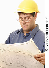 Architect or Project Manager - A man reading architectural...