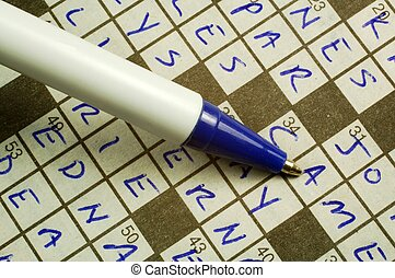 Crossword Puzzle - A crossword puzzle and pen