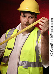 Measure up - Builder with his trusty tape measure on a...