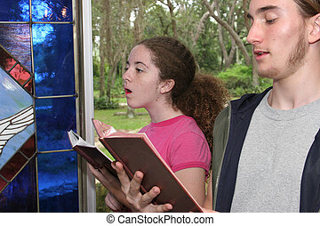 Singing Hymns In Church 2 - a teen boy and girl singing...