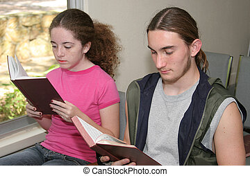 Teens In Church - a teen boy and girl in church opening...