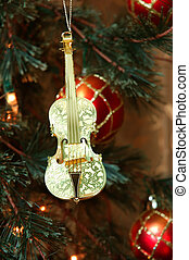 Violin - Shiny gold violin ornament hanging on a Christmas...