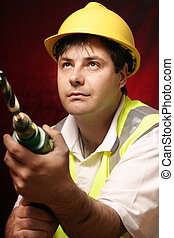 Tradesmen with a drill - Tradesmen with his drill and large...