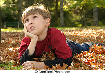 Resting in Parklands - Child resting in a park amongst...