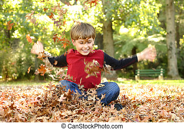 Autumn Action - Child playing in leaves and laughing...